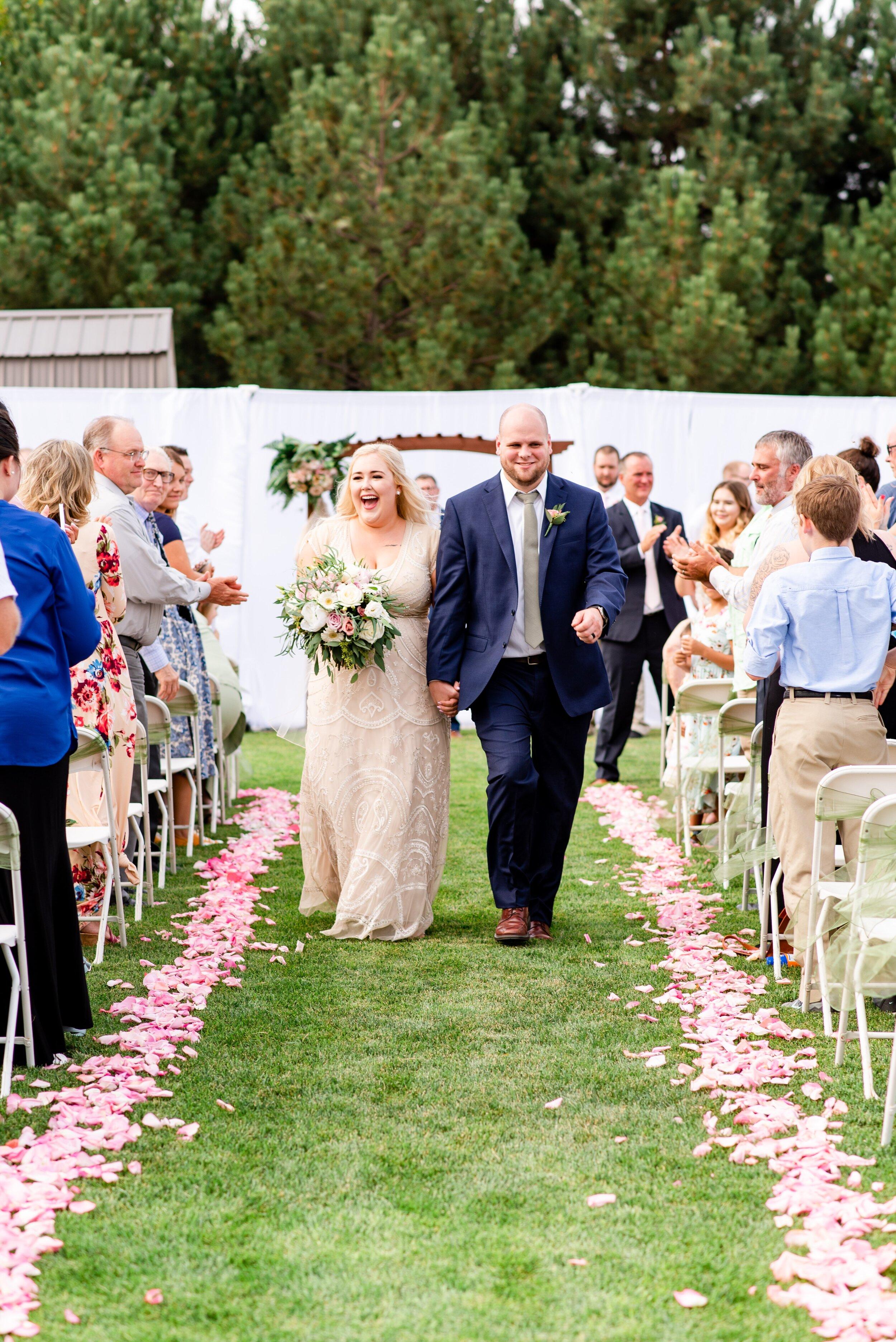 Bride & Groom Walking Down Aisle - Tri Cities Wedding Photographer - Morgan Tayler Photo & Design - Tri Cities Washington Backyard Wedding