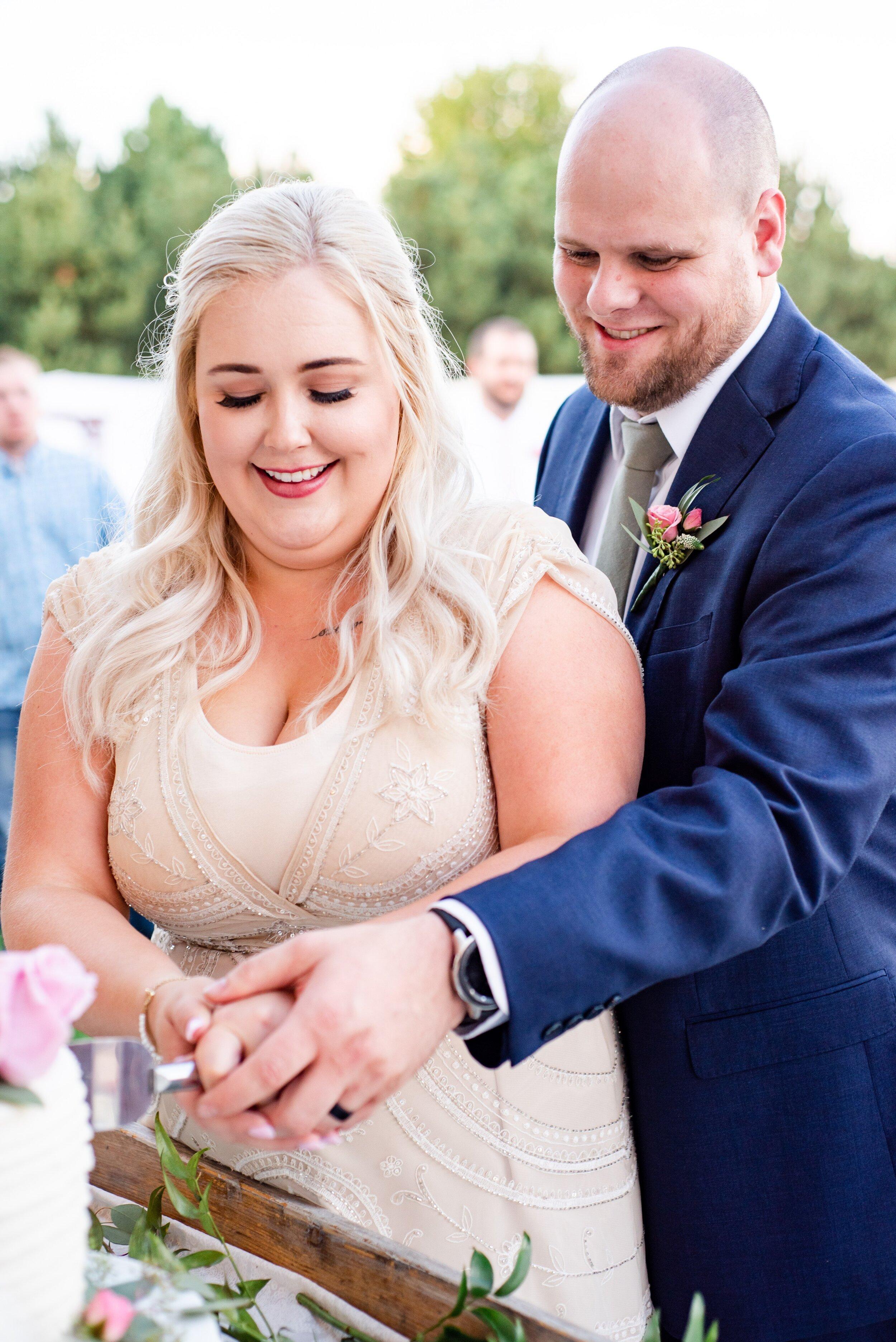 Bride & Groom Cutting Cake - Tri Cities Wedding Photographer - Morgan Tayler Photo & Design - Tri Cities Washington Backyard Wedding