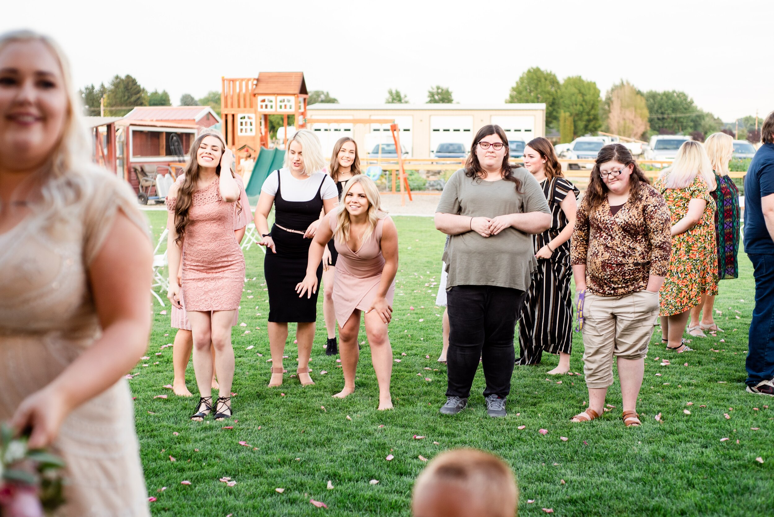 Bouquet Toss - Tri Cities Wedding Photographer - Morgan Tayler Photo & Design - Tri Cities Washington Backyard Wedding