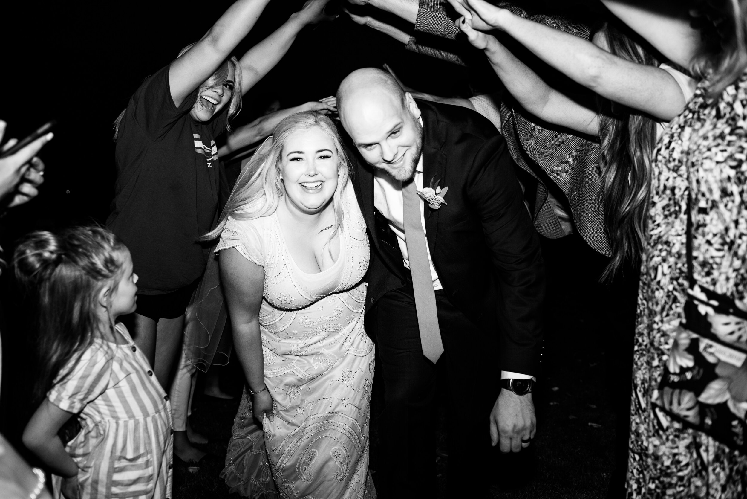 Bride & Groom Exit Tunnel - Tri Cities Wedding Photographer - Morgan Tayler Photo & Design - Tri Cities Washington Backyard Wedding
