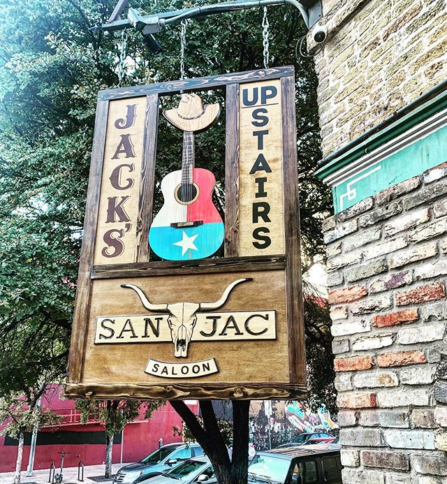 "Nothing says ""Welcome to Texas"" like our new street sign! Come see it tonight, along with our Friday night band, Nine Pound Hammers, starting at 10pm! • • • #SanJacSaloon #JacksUpstairs #newsignwhodis #barsigns #Texaspride #Texasmusic #TXflag #streetsign #countrymusic #Texascountrymusic #TX #Austinvenues #ATX"