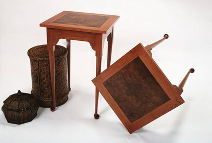 """Slipper-foot"" end tables with myrtle burl inset tops"