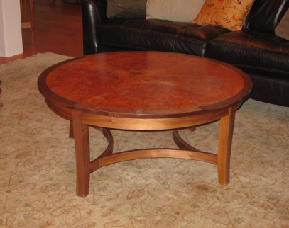 Walnut coffee table with unusual base and contrast inset top