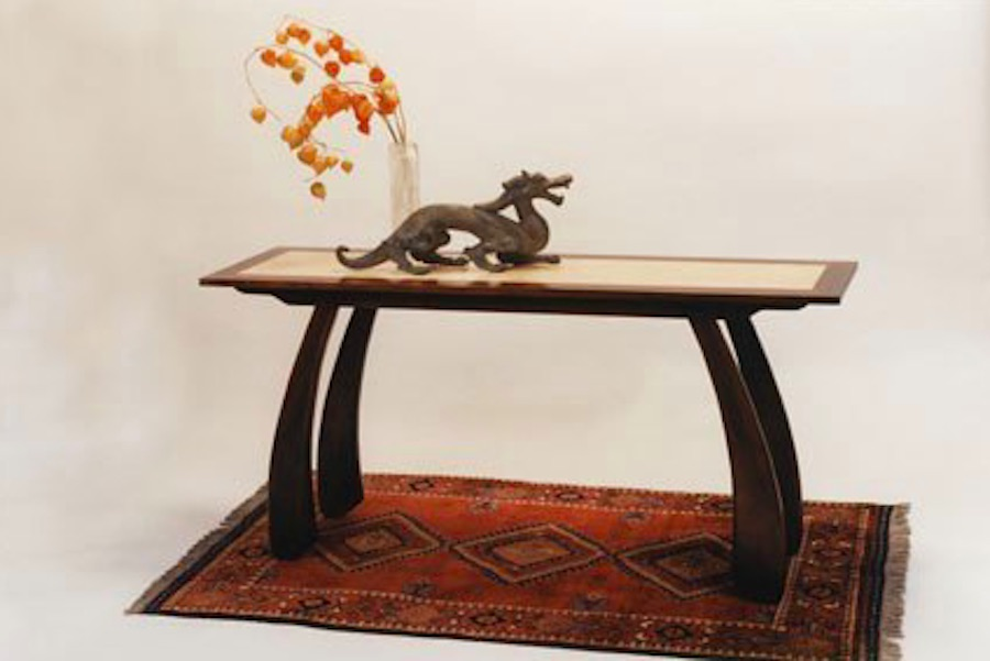 "Named the ""Dragon"" table for the calligraphy inspired legs and the ""floating"" top, this style features a dark base with a contrast inset"