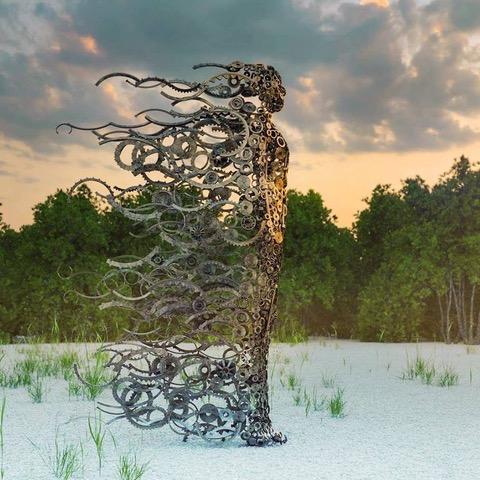 """Sculpture inspired by Penny Hardy's original, """"You Blew Me Away."""" The artist of this piece is unknown. If you know who the artist is, please let us know, so we can give credit, where credit is due! Thanks!"""