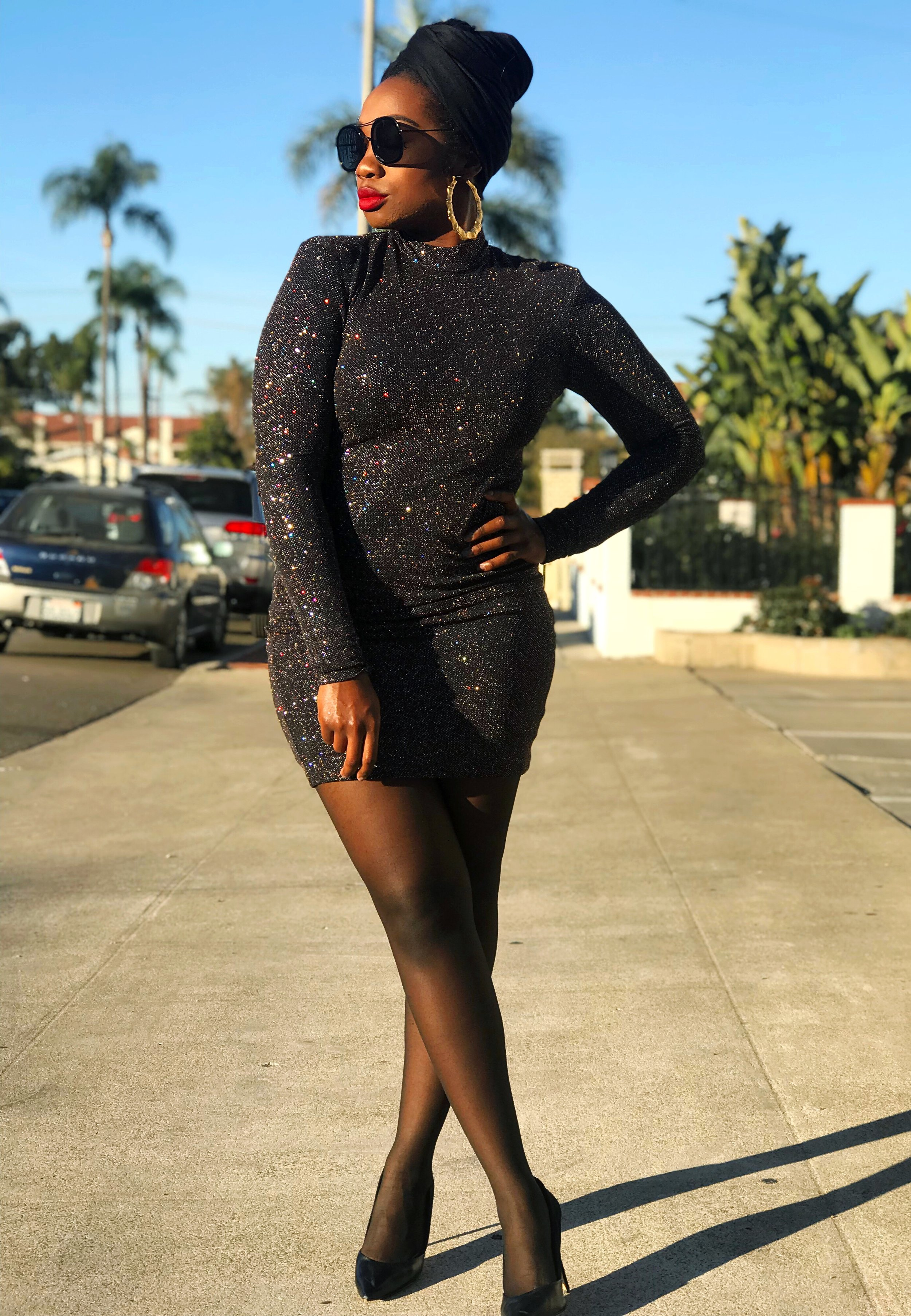 Femi wearing sparkly New Year's Even Inspiration dress - Wrap Queen