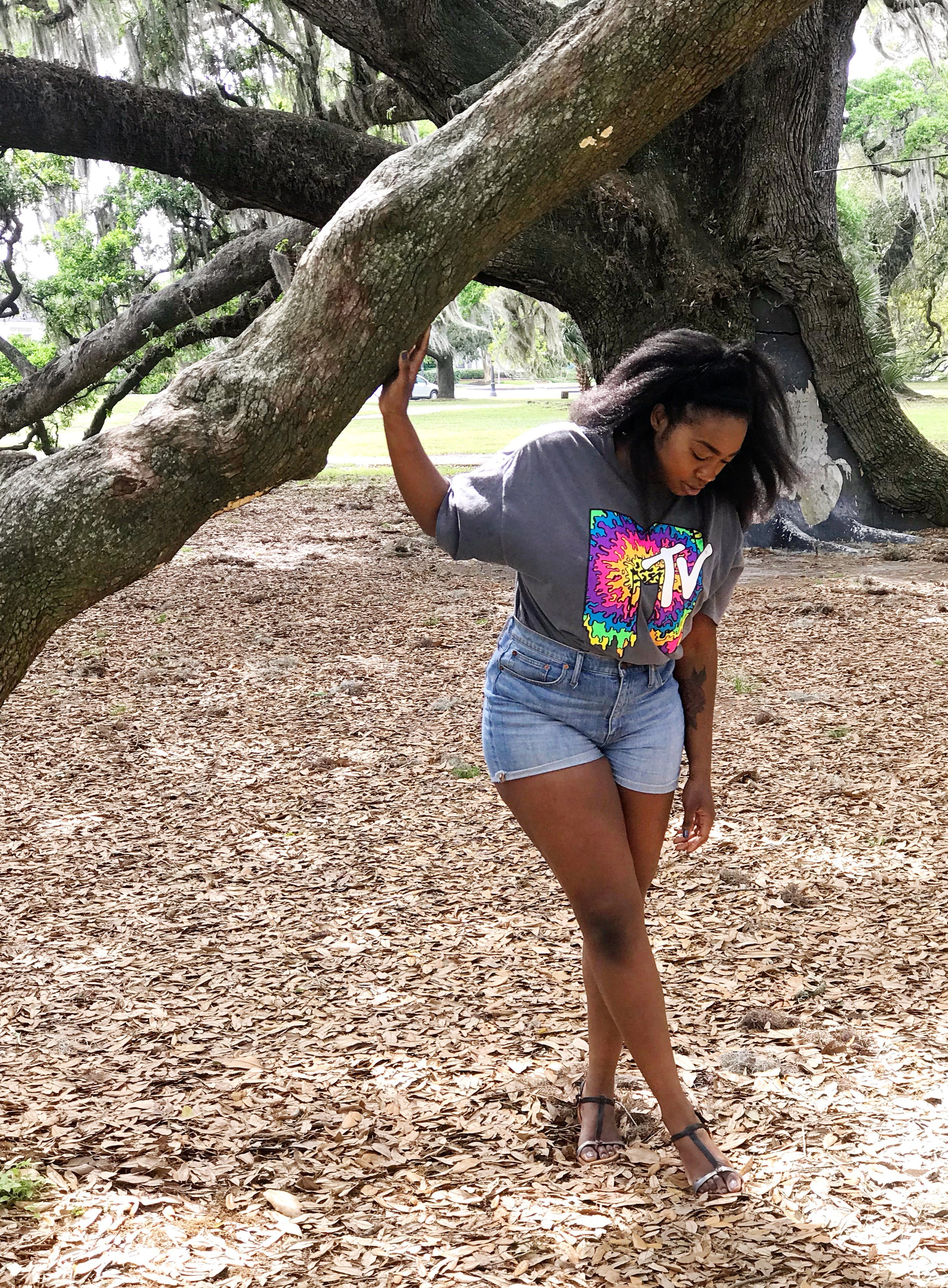 Femi wearing MTV graphic tv standing in City Park, New Orleans