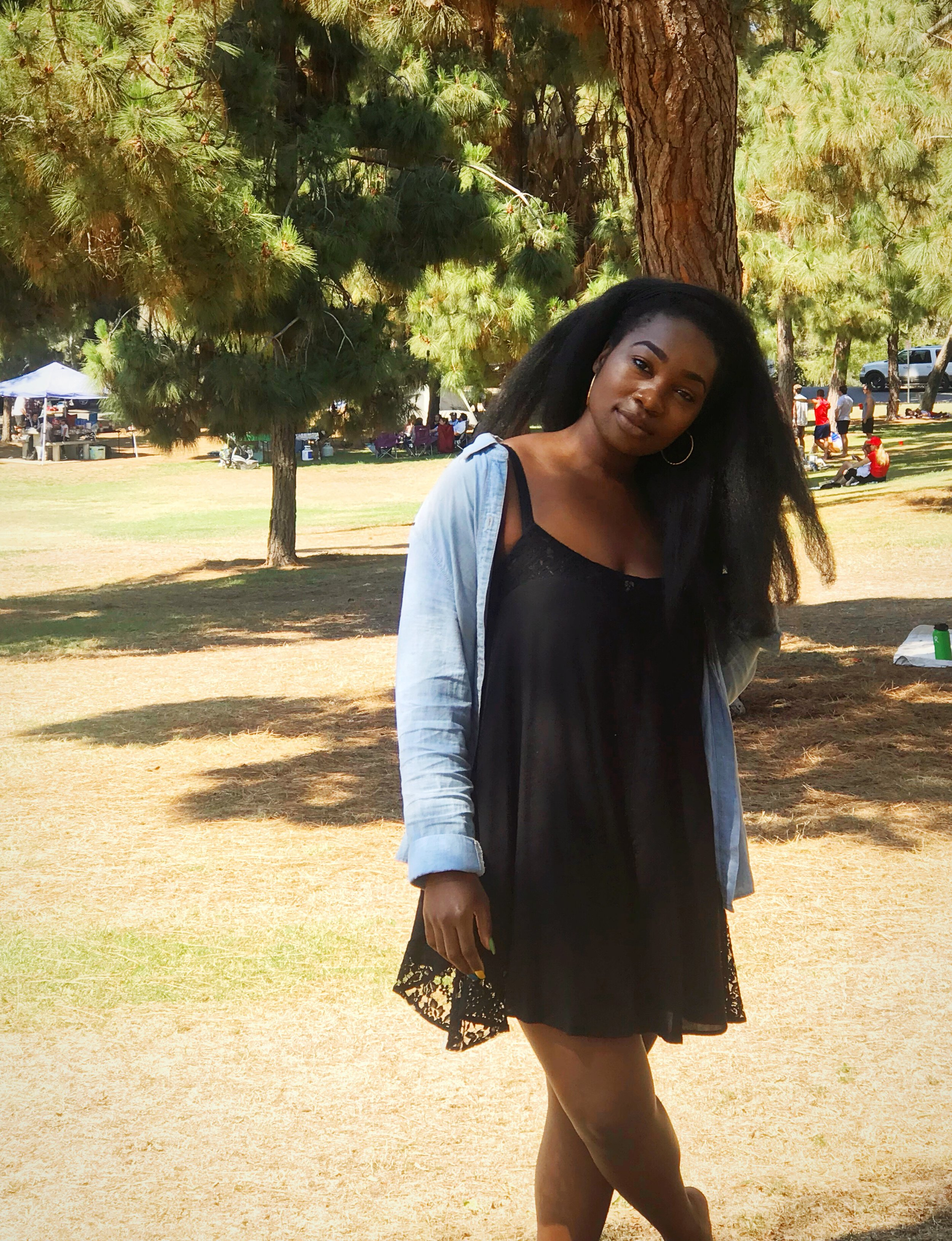 Image: Femi in black dress and chambray in Presidio Park