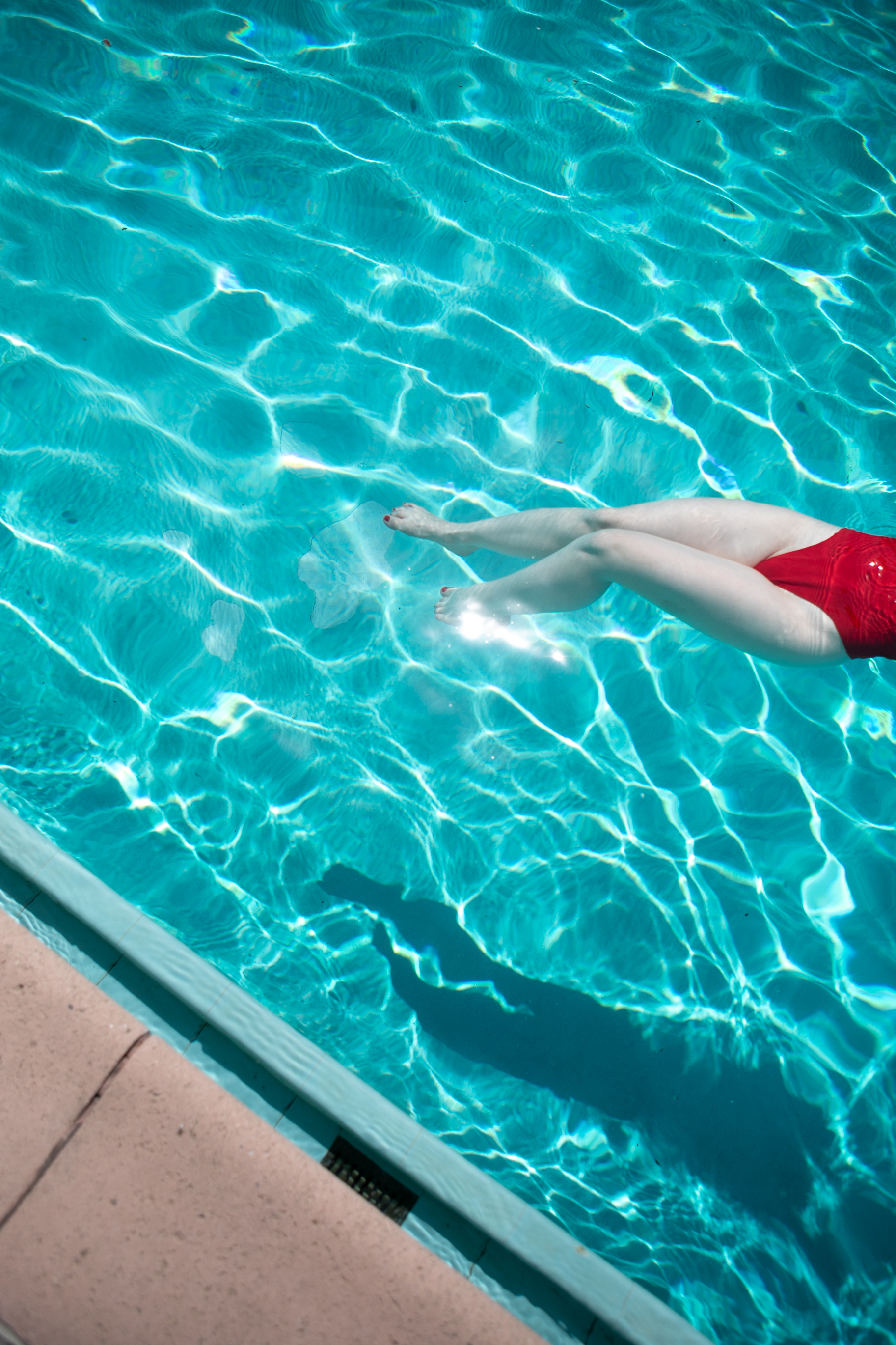 Red Bathing suit in pool, Silverlake, LA California. Photograph by Sarah Natsumi Moore