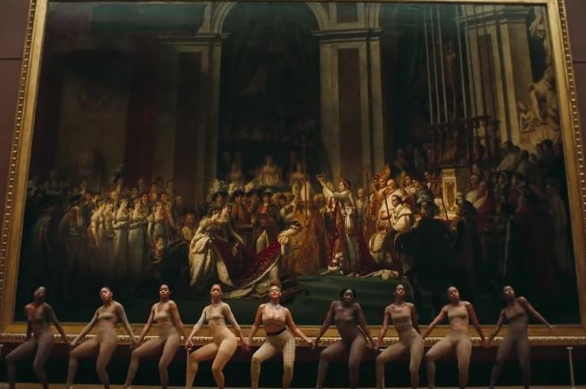 Beyoncé (center) accompanied by dancers, performs in front of Jacques-Louis David's monumental painting  The Consecration of the Emperor Napoleon and the Coronation of Empress Joséphine , 1807