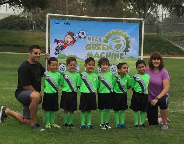 Coach Kelly with the Mean Green Machine (her son Kevin is the fourth child from the left) in September 2016