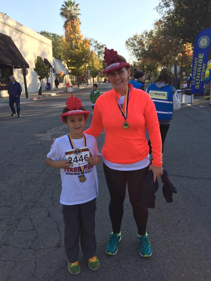 Kelly after running a Turkey Trot with her son Dominic in November 2016