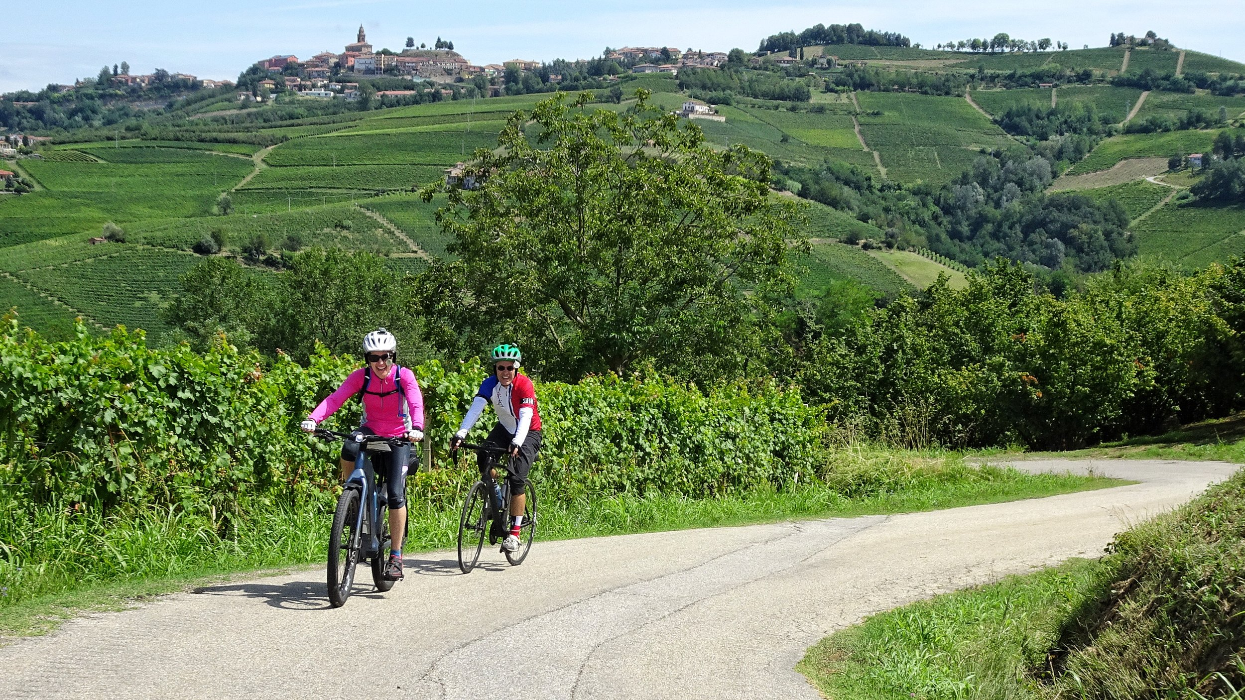 Ride up to Diano d'Alba through thousands of grapes vines.