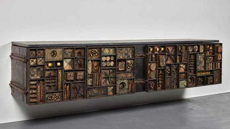 Right: A wonderful Paul Evans Forge/ Sculpture Front cabinet 1973, made of brass, copper, steel, and gold leaf seen here with his Argente box table. The Exchange Int have one of the most important Paul Evans collections, especially of his studio works
