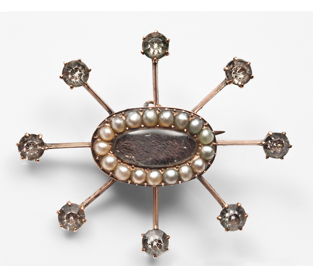 Above: Paste diamonds add drama to a pearl and hairwork brooch c.1820.