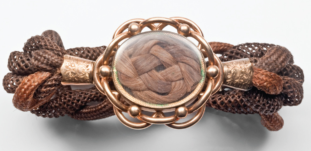 Left: This elaborate sentimental hairwork bracelet dated 1858 combines the hair of seven family members