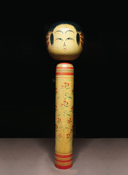 An example of a 'Sakunami' style Kokeshi doll orginating from the Sakunami hot springs.