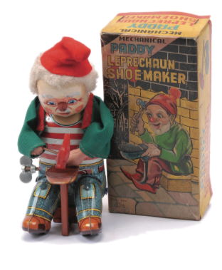 A 1950s novelty clockwork figure and box made by Alps: 'Mechanical Paddy Leprechaun Shoemaker'. While his face and outfit has been tinprinted, his jacket and hat are felt. Complete with hammer, tinplate shoe and nail. Sold for £96 in April 2013