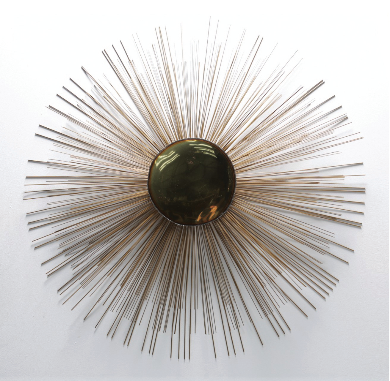 Large Sunburst wall sculpture. Price £1,325. Available from Mid-century Online.
