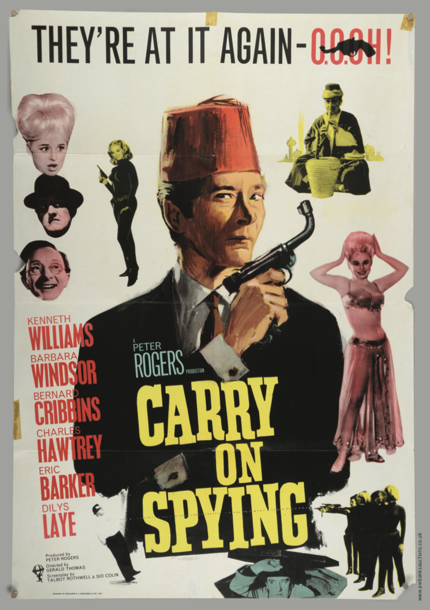 A rare one-sheet poster for the 1964 James Bond spoof film  Carry On Spying  depicting a barrel bent upwards, wielded provocatively by Kenneth Williams. This poster had to be withdrawn and replaced with one showing a straight barrel following the threat of legal action!