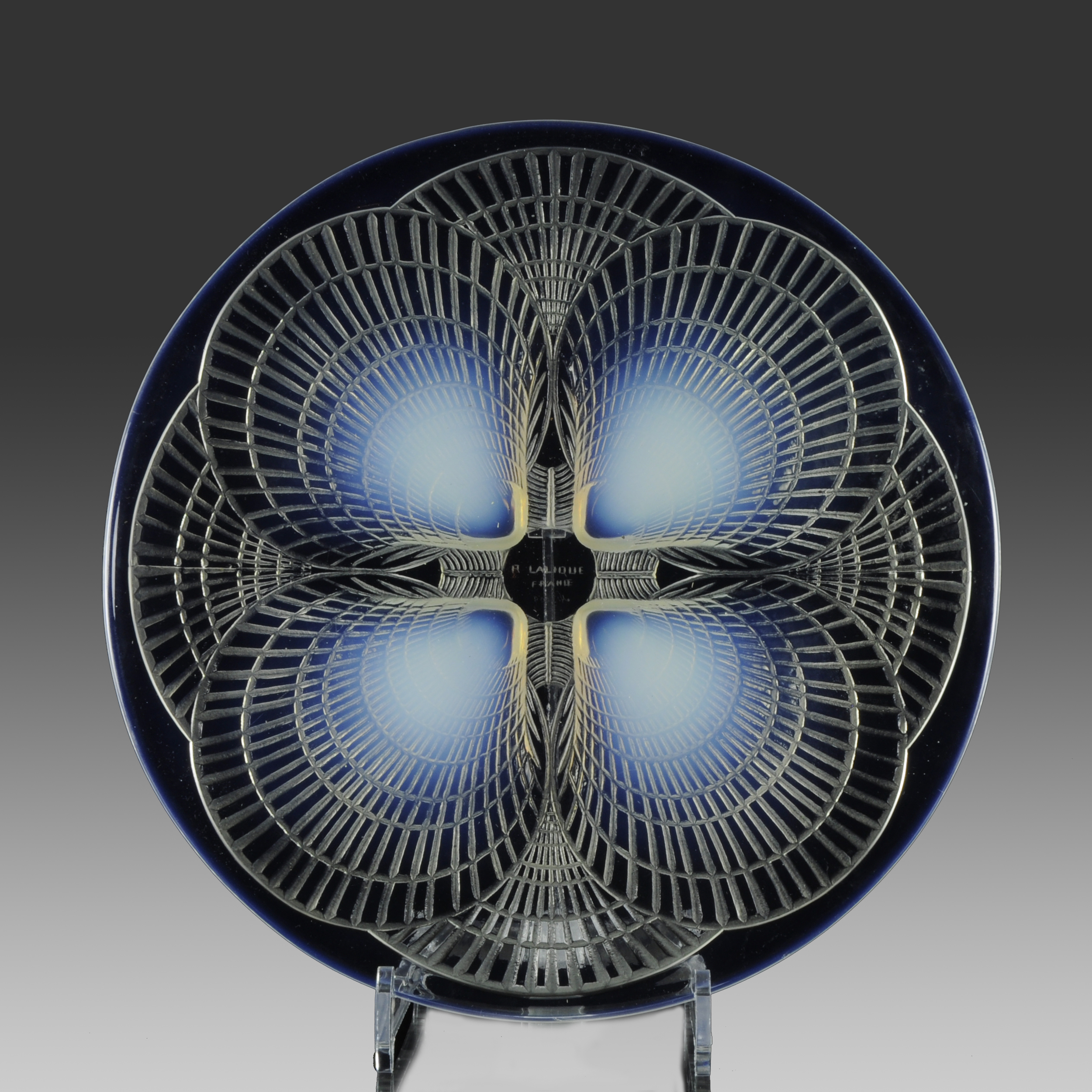 Stunning Art Deco glass signed by René Lalique; a plate with frosted surface effect and raised scallop shells in a deep sky blue opalescent colour. Price £850. From Hickmet Fine Arts    (hickmet.com)