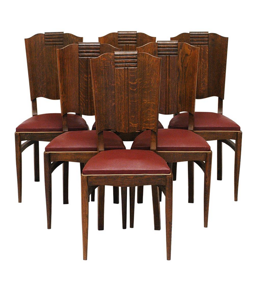 Below: Set of six carved oak dining chairs in original period burgundy Rexine with cream piping. Price: £2,100. Available from    molecula.co.uk