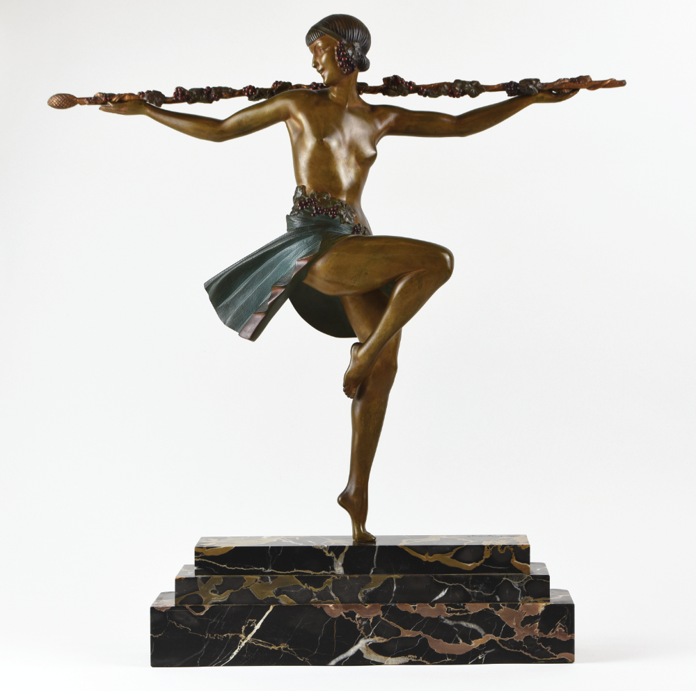 A cold painted, gilt bronze sculpture on a marble plinth dating from 1925. 'Dancer with Thrysus' by Pierre Le Faguays. Price: £13,950 available from    solo-antiques.co.uk