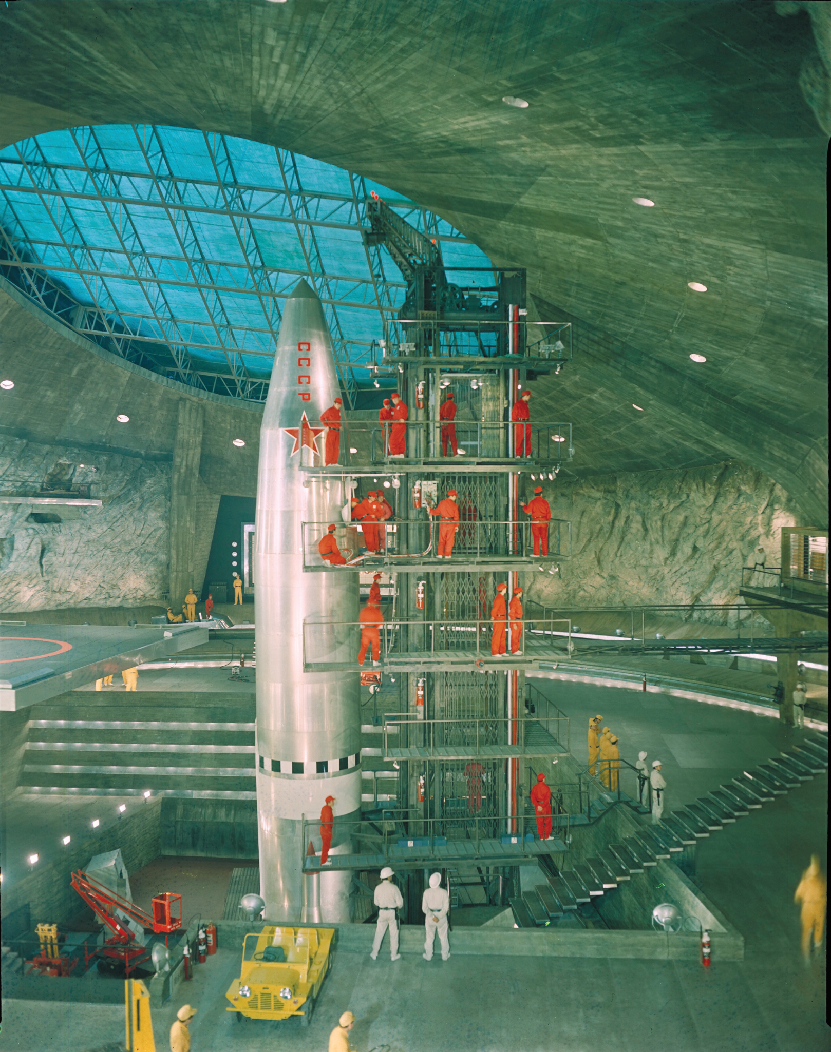 Left and above: Ken Adam's early concept art for the volcano set on You Only Live Twice. Inside the Volcano, SPECTRE's crewmen work on the rocket which is being prepared for an attack on a Soviet target