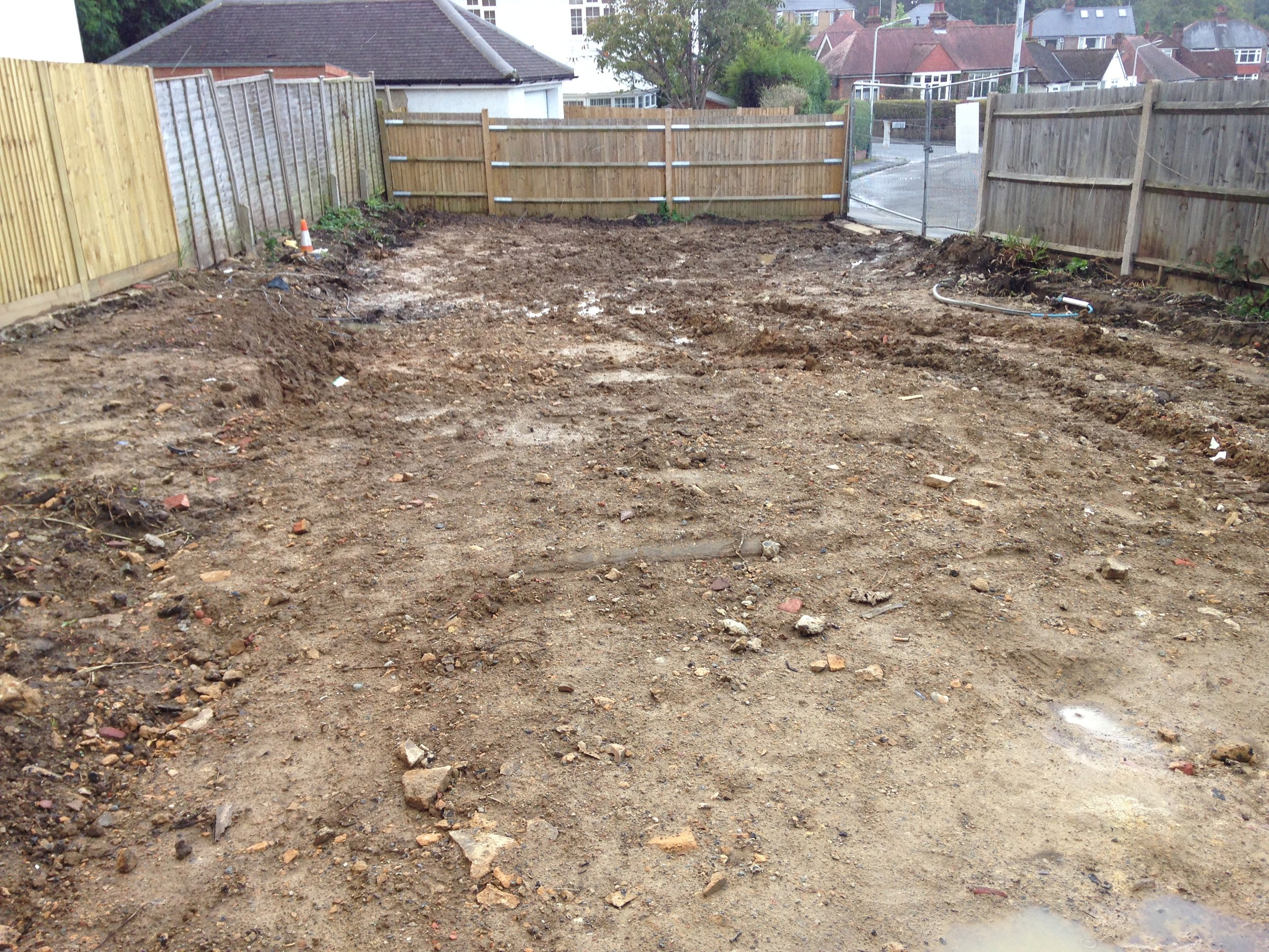 Photograph showing the site prior to construction once the garage and hard standing had been removed.