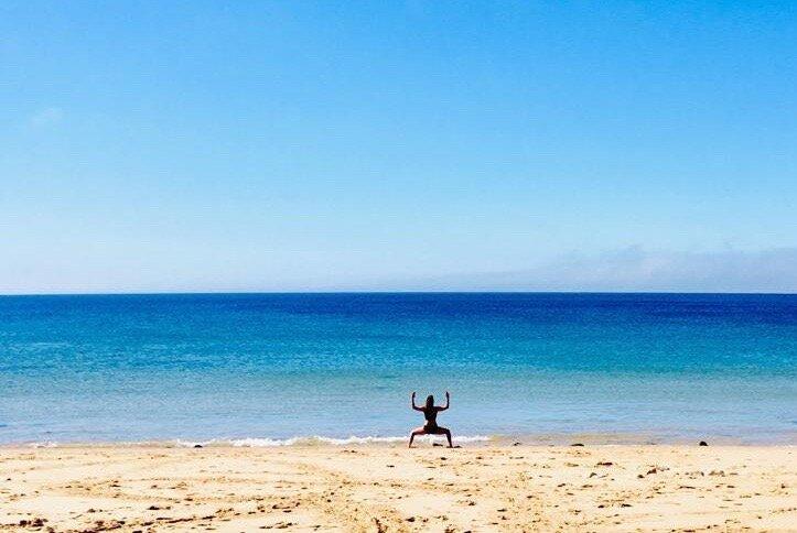 Michael practising the Goddess Pose in Praia da Mareta, Sagres