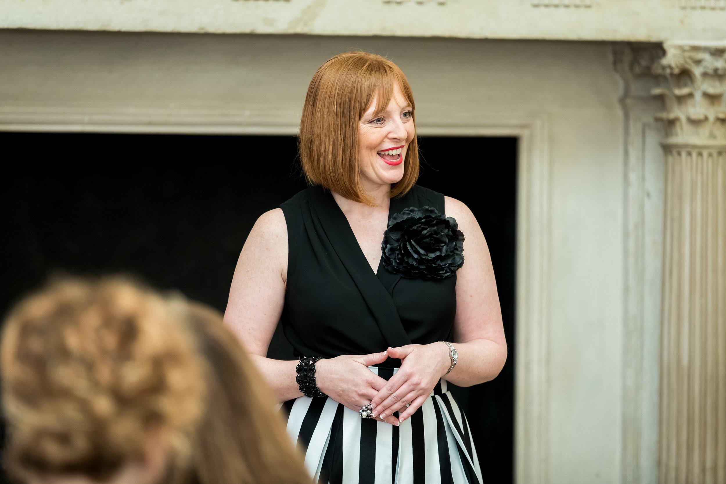 Lori Rae speaking at The Ritz, London England.