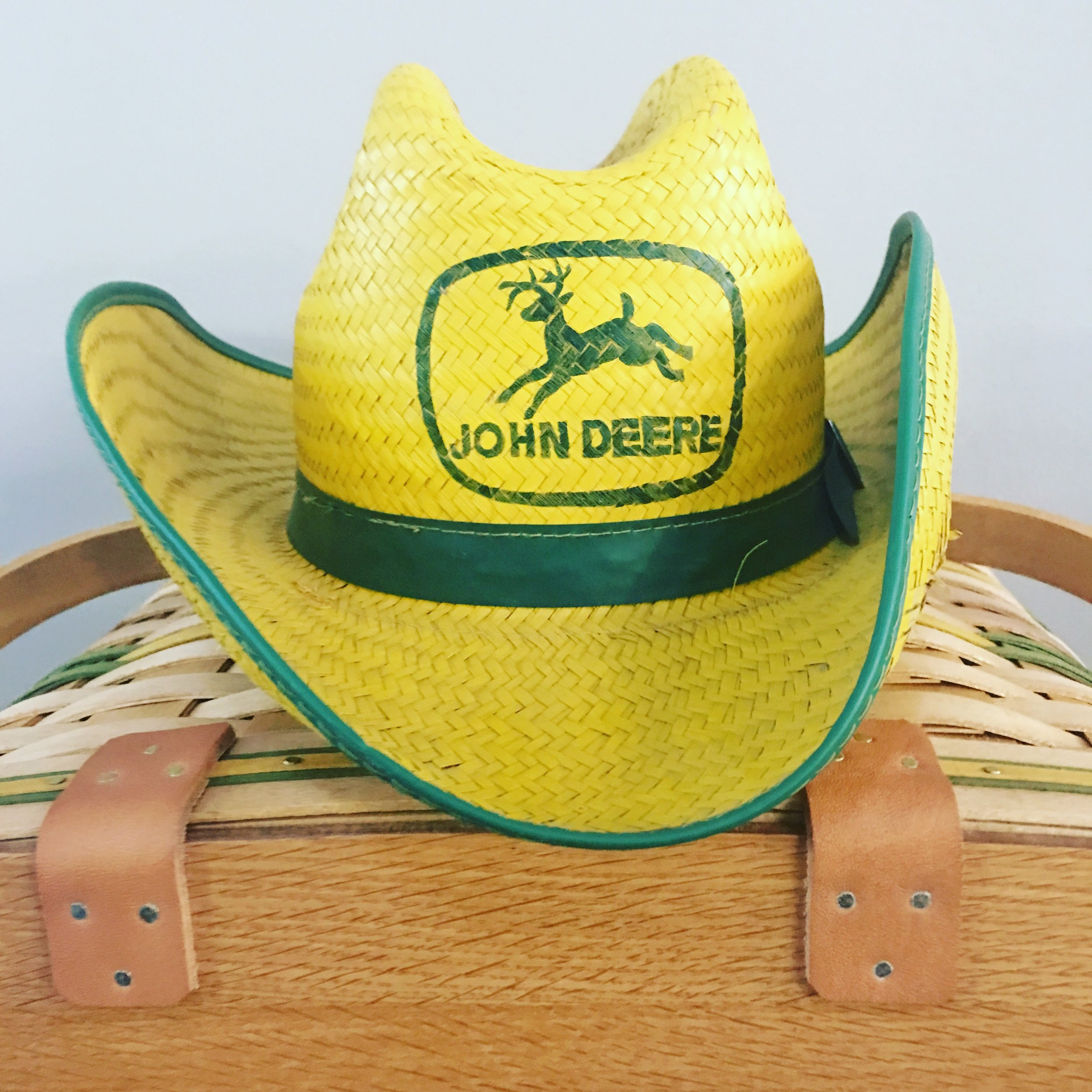 The winter farm toy auctions also have great memorabilia like this original John Deere straw hat.