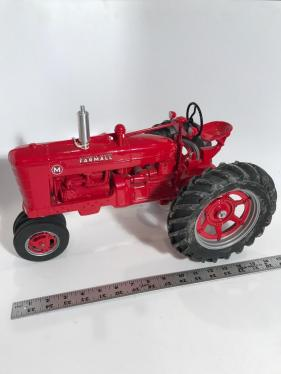 Farm Progress Show collector edition Farmall M die-cast tractor, which appears to be signed by Joseph Ertl