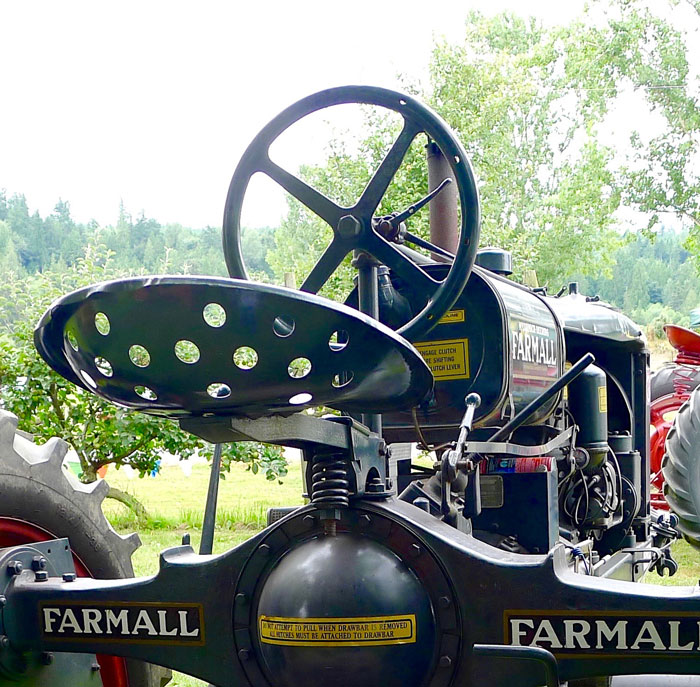 The seat on this McCormick-Deering Farmall was deep enough to give some security and had plenty of air circulation, but still does not look too comfortable.