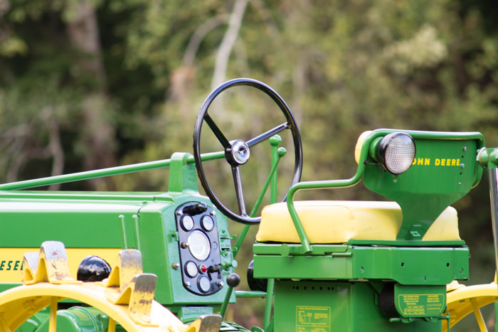 """Mike and Bryan Koskela's 1958 John Deere 720 sports this """"Float Ride"""" cushioned seat."""