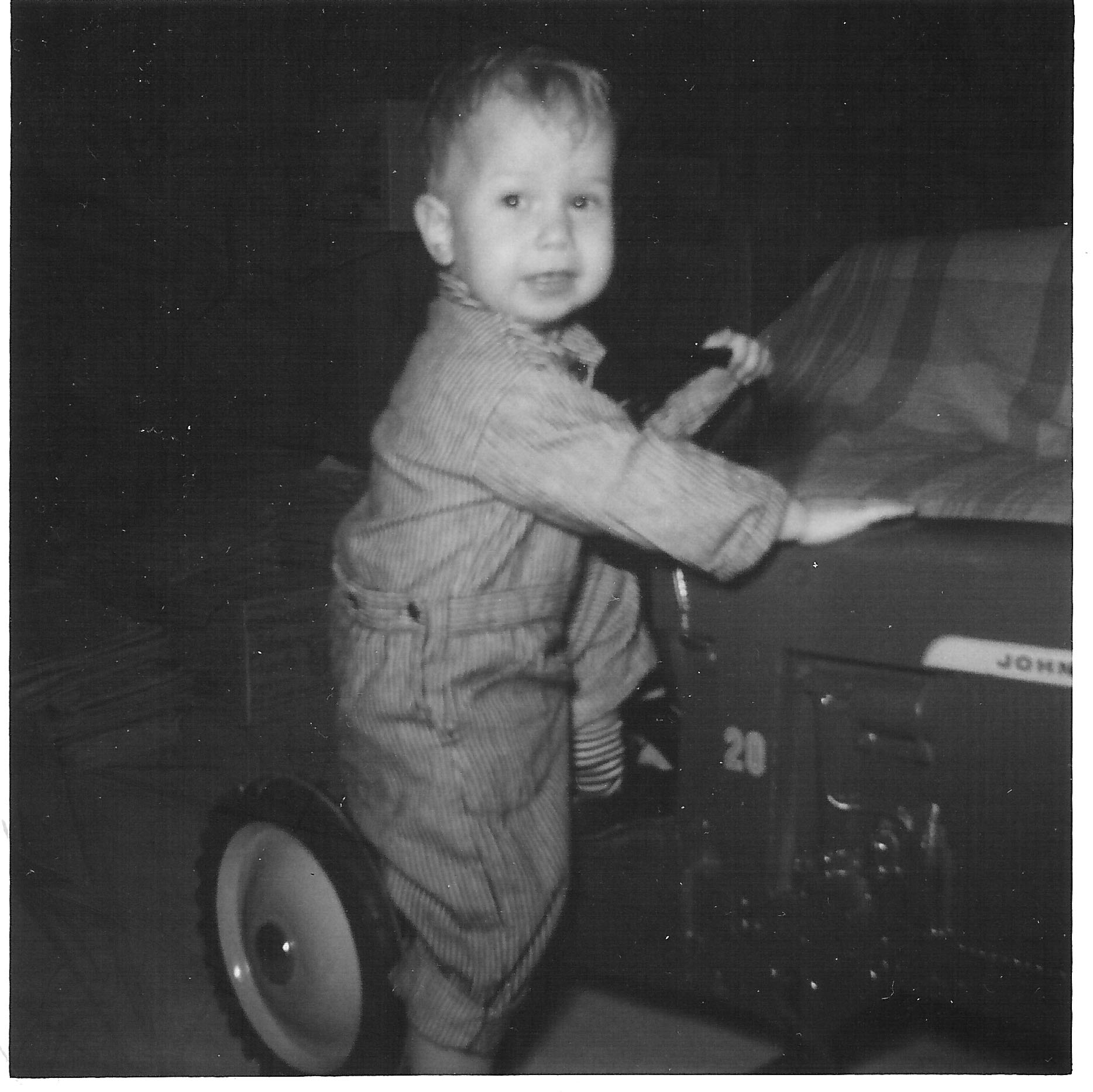 All dressed up and ready to ride my John Deere pedal tractor in the late 1960s.