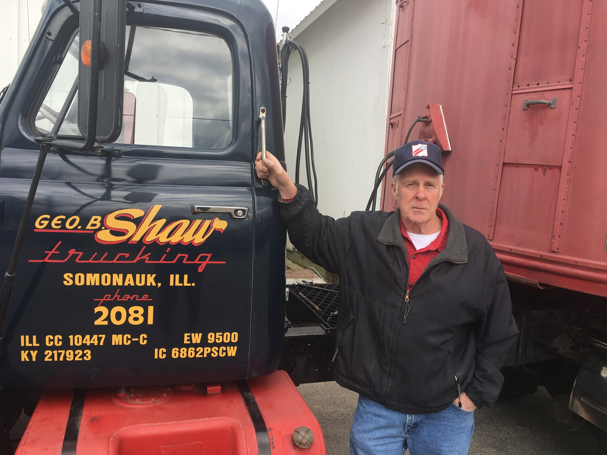 Jerry Shaw stands near his rolling tribute to his father. He brought this museum to the Sublette Farm Toy show.