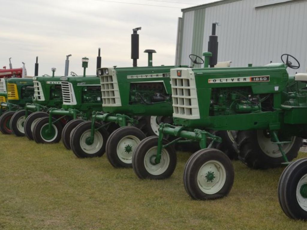This is a lineup of a few of the tractors that will be auctioned from the Sparky Duroe collection.   Aumann Auctions