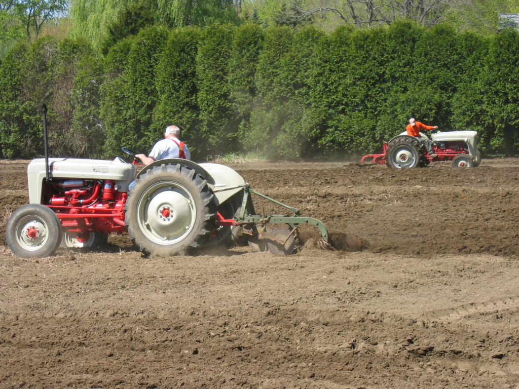 Two Ford tractors work the field for the Scantic Valley Antique Engine & Tractor Club's 2010 plow day.  Photo Scantic Valley Antique Engine & Tractor Club