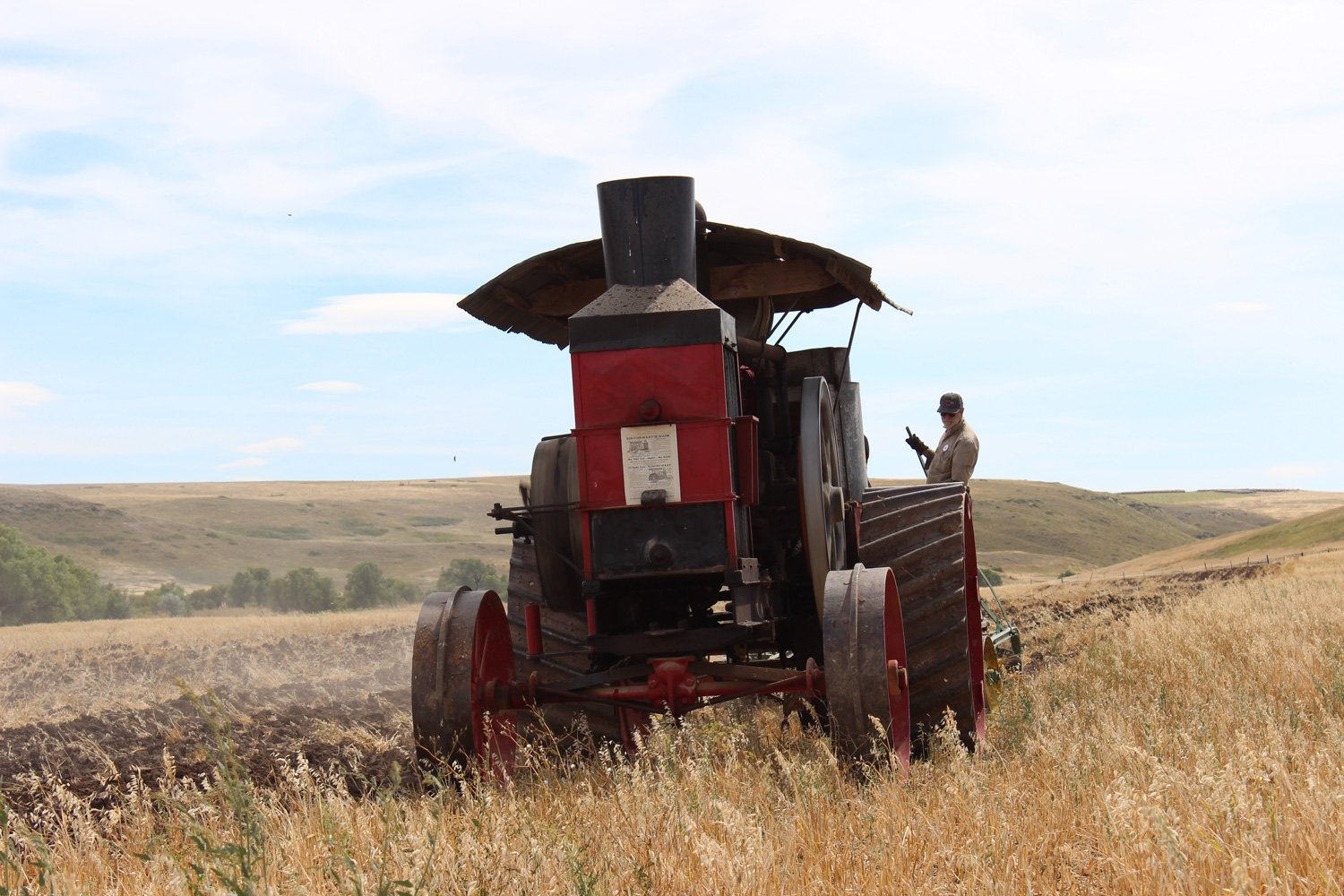The Hart Parr 30-60 Old Reliable tractor, with its hit-and-miss firing away, made an unforgettable sound echoing off the nearby hillsides.  Photo Luke Steinberger