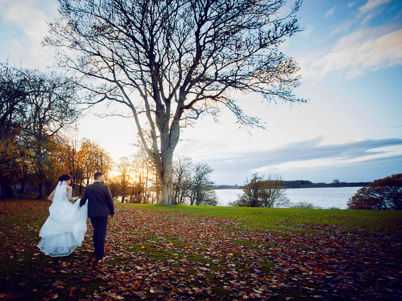 Tulfarris Hotel & Golf Resort wedding couple with views of Blessington lakes.jpg