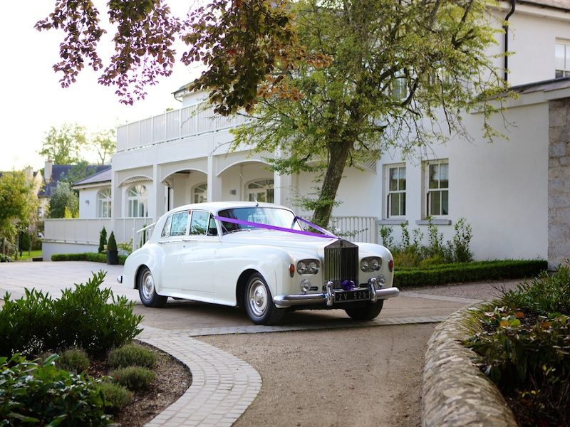 A vintage white car outside the Manor House at Tulfarris Hotel in Wicklow
