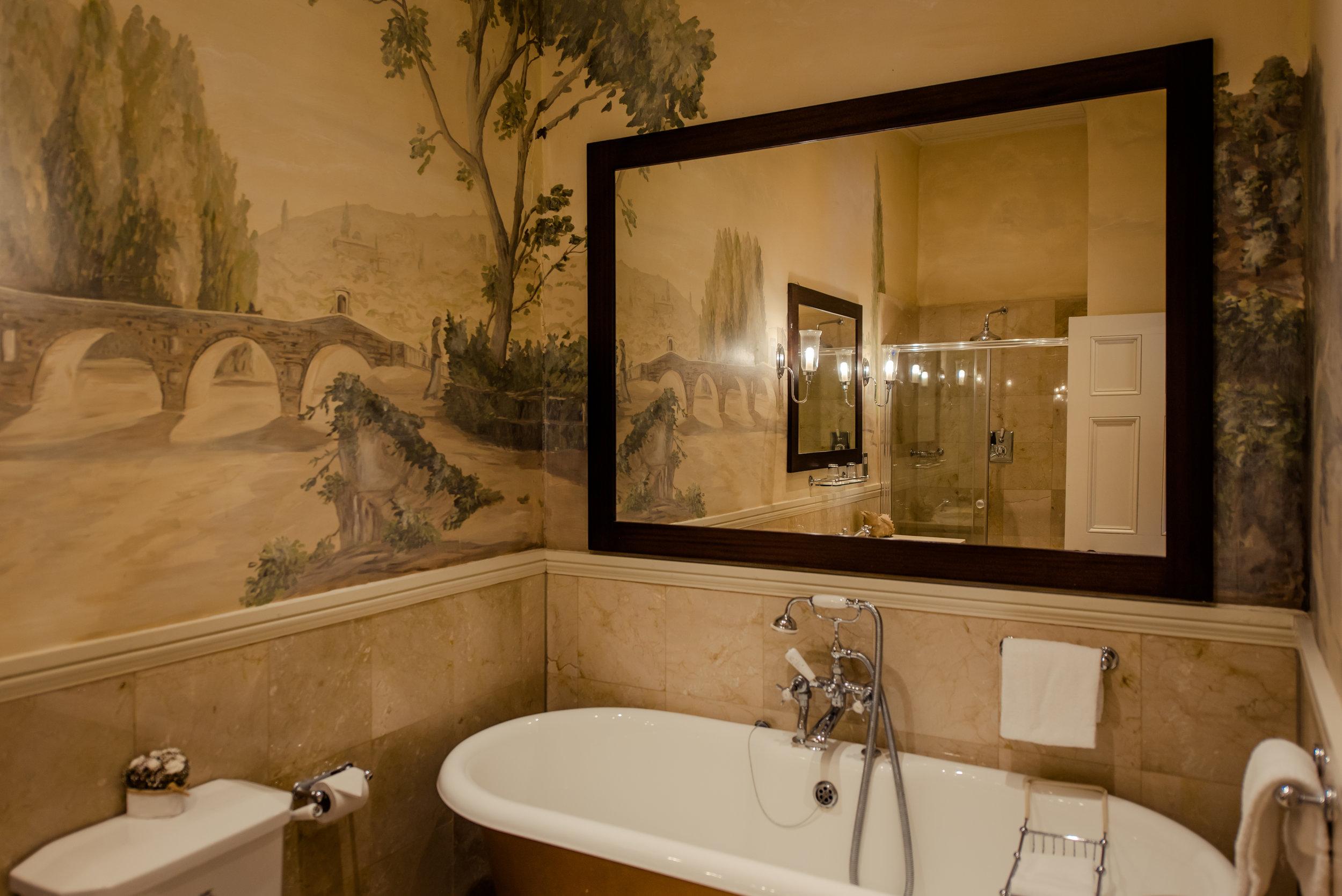 Tulfarris Hotel & Golf Resort bridal suite bathroom with large mirror over bath.jpg