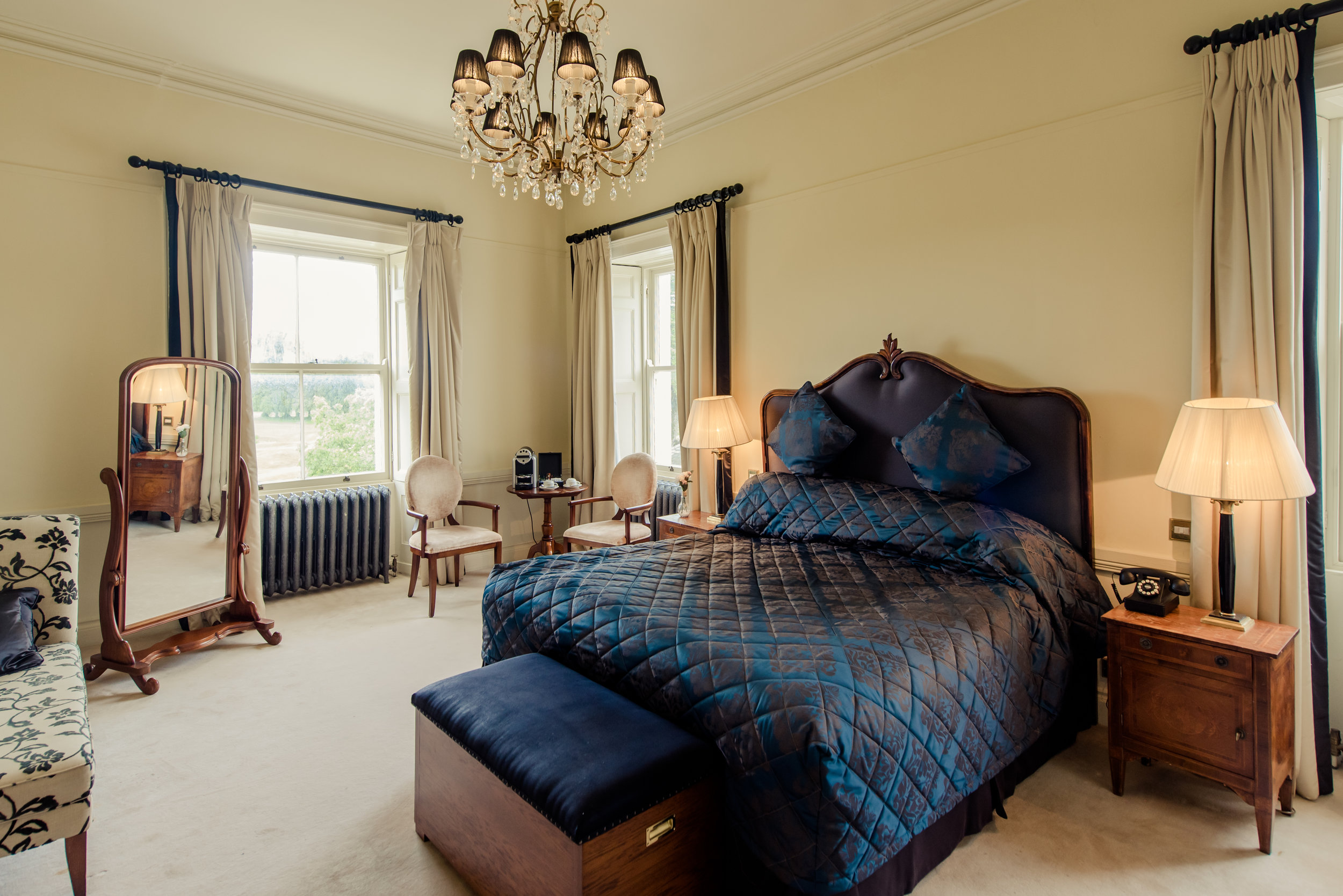 Tulfarris Hotel & Golf Resort Manor House bedroom entire view with mirror and window views.jpg