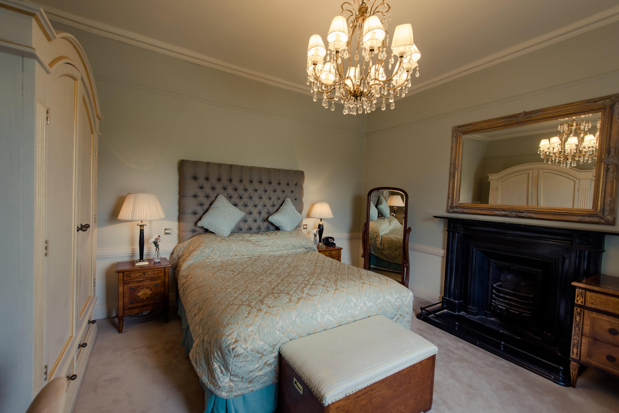 Tulfarris Hotel & Golf Resort Manor House bedroom with light blue setting.jpg