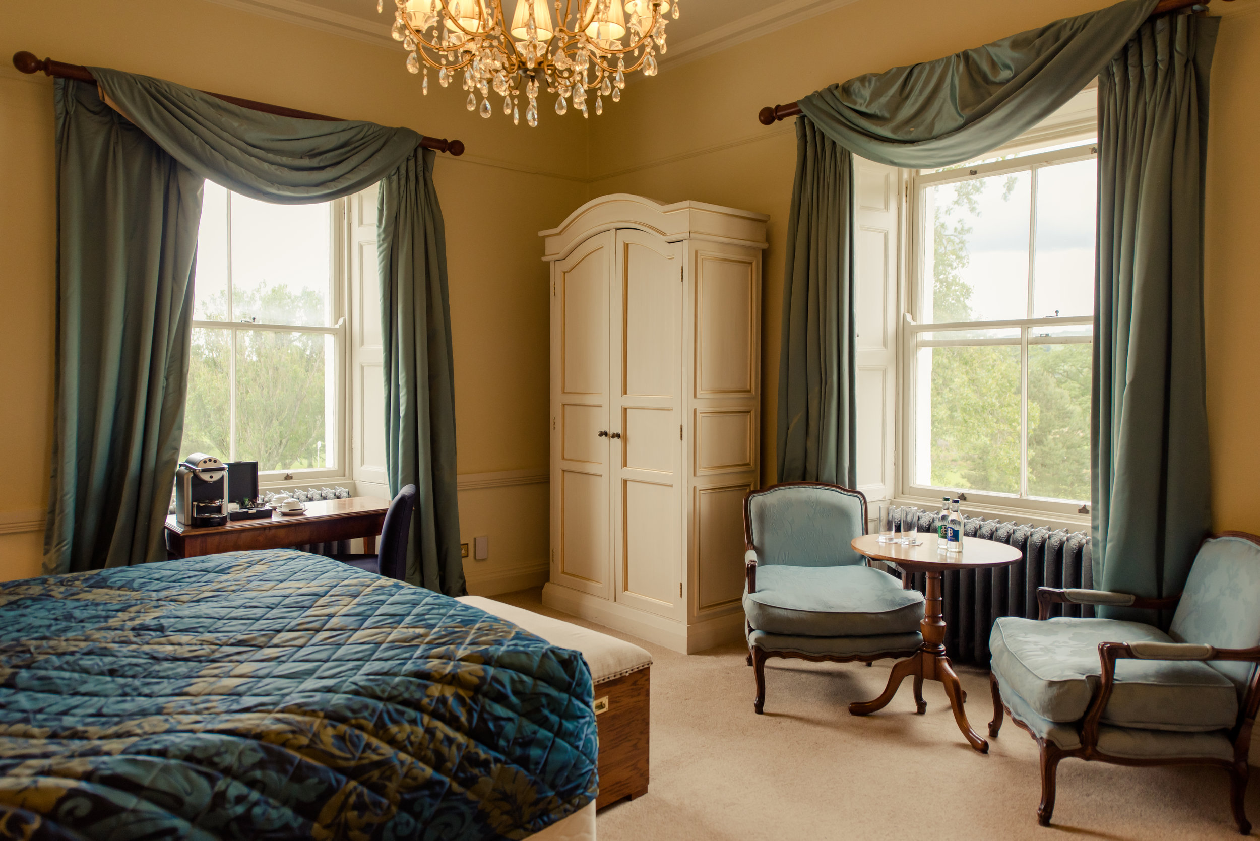 Tulfarris Hotel & Golf Resort Manor House bedroom with view out of two windows.jpg