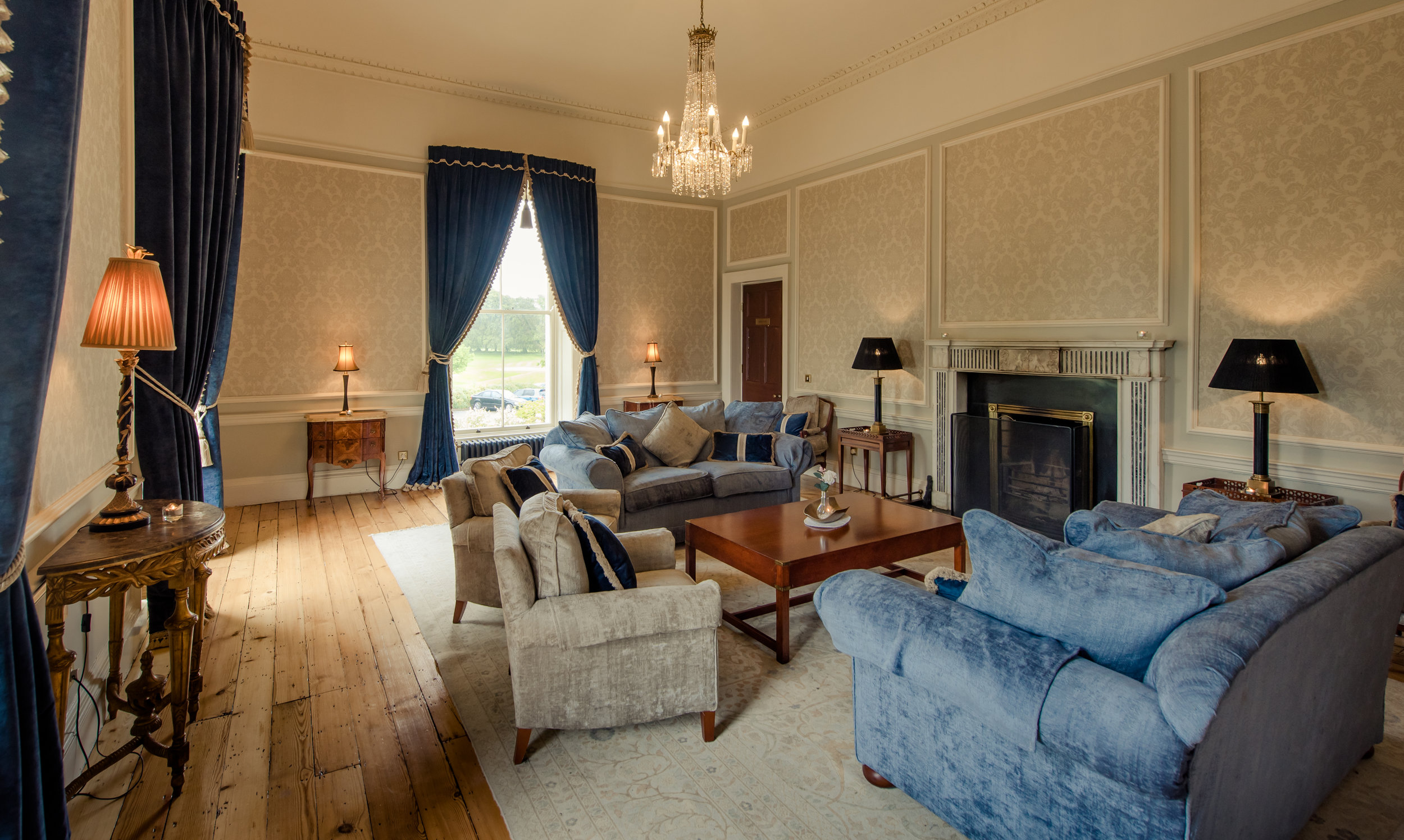 Tulfarris Hotel & Golf Resort Manor House living area with fireplace.jpg