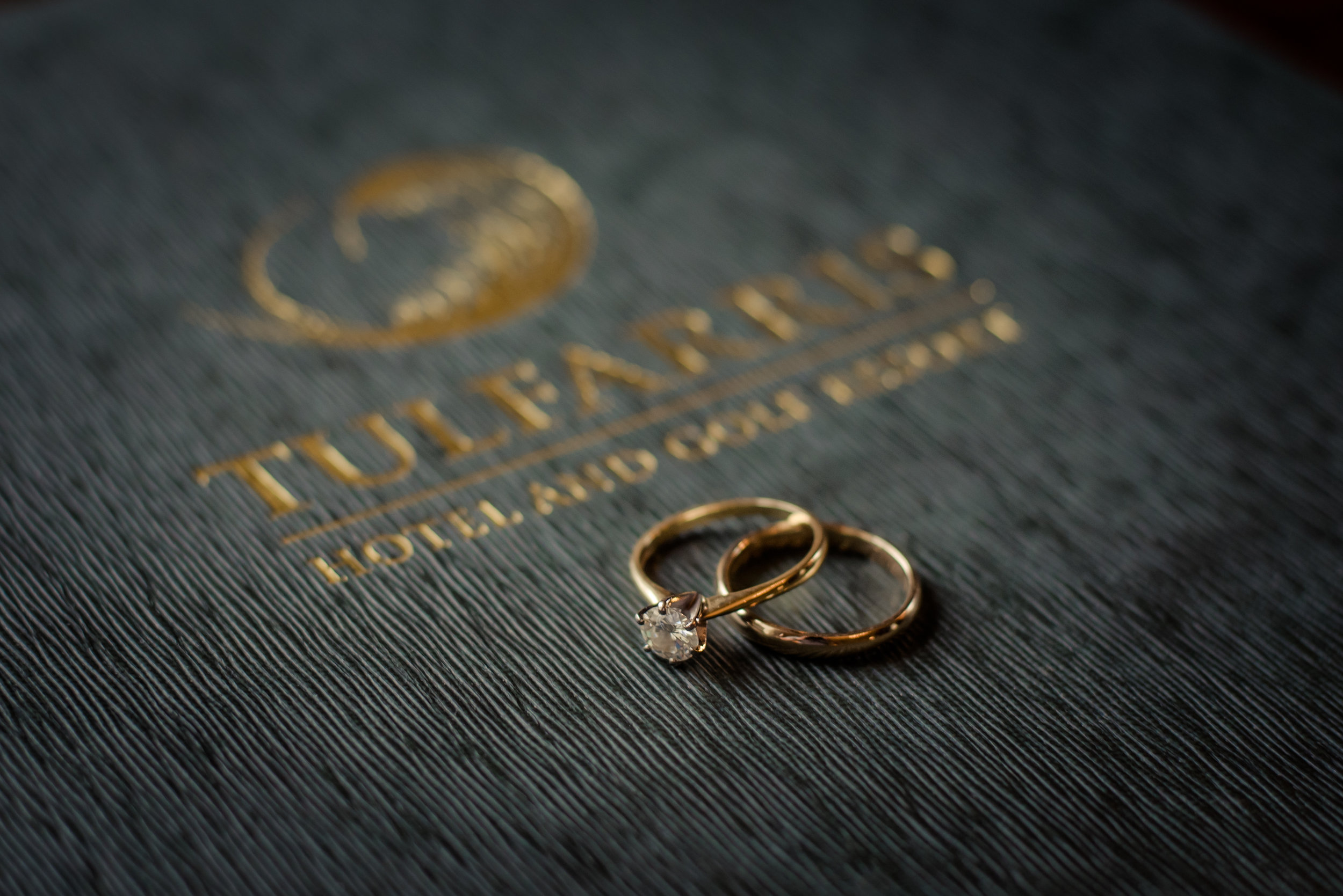 Tulfarris Hotel & Golf Resort wedding rings on bedroom information booklet.jpg