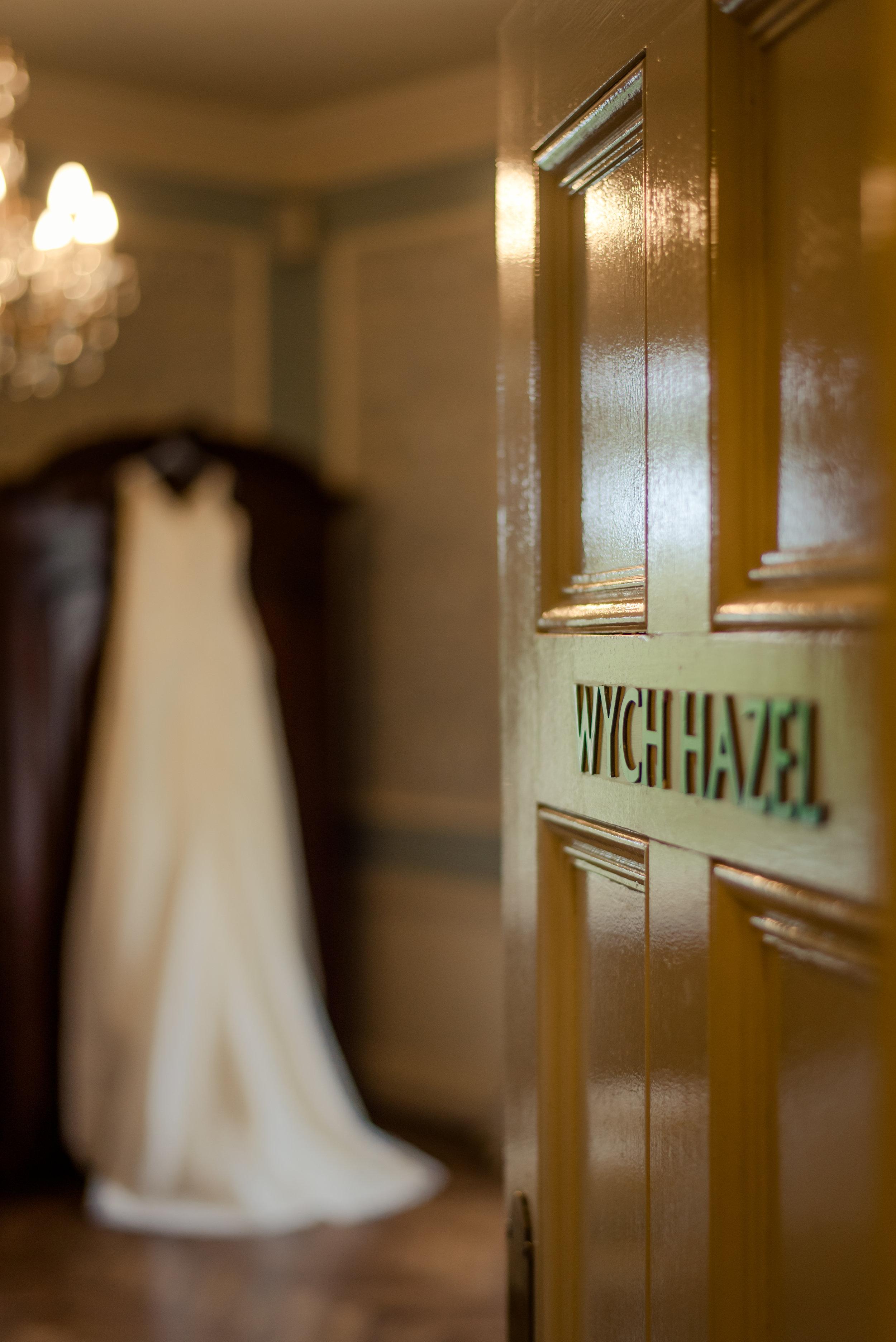 Tulfarris Hotel & Golf Resort Wych Hazel bridal suite with door open a wedding dress hanging up.jpg