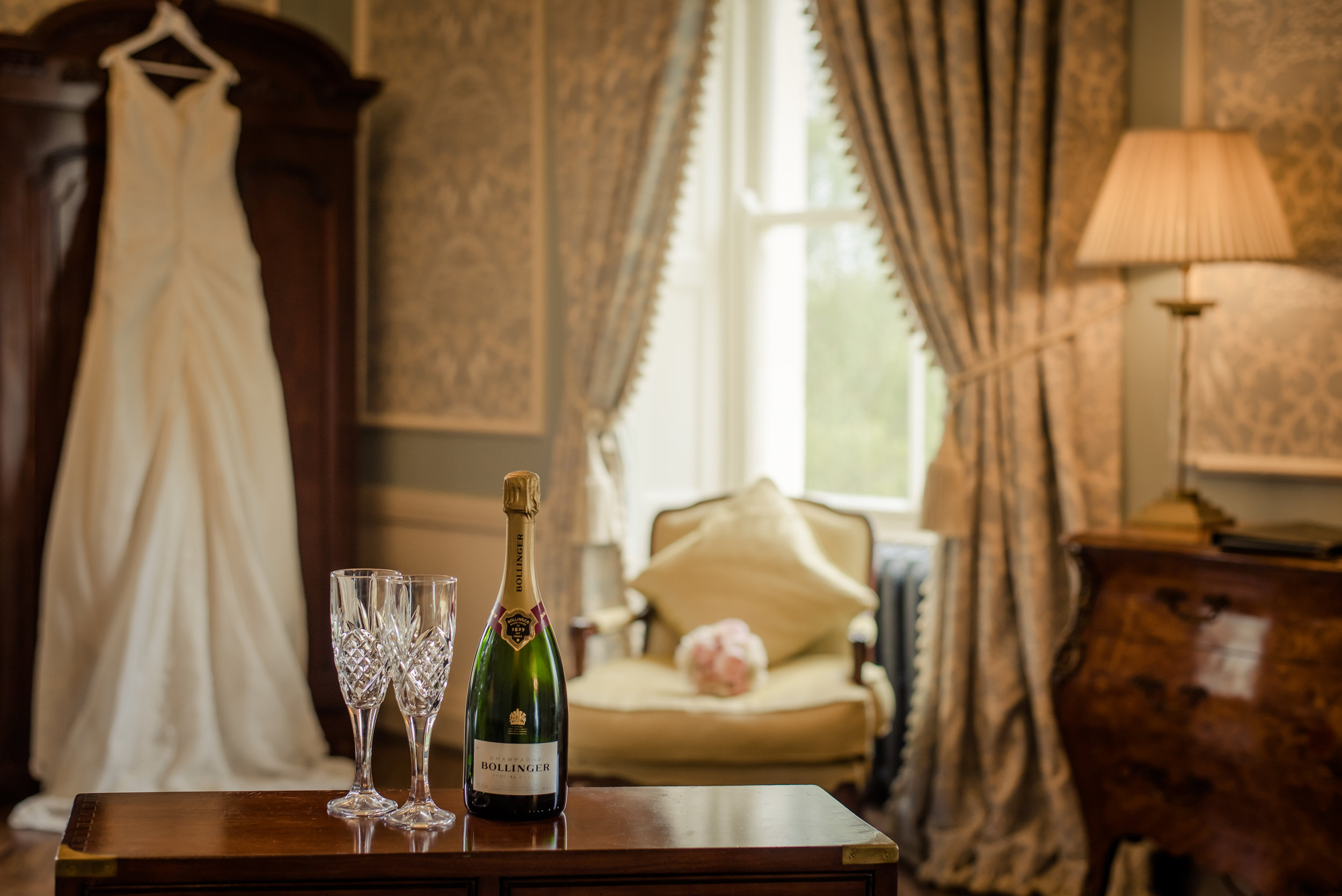 Tulfarris Hotel & Golf Resort bridal suite with champagne and wedding dress in the background.jpg